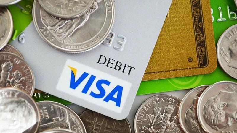 Ilustrasi kartu debit. Photo by Russ Ward on Unsplash